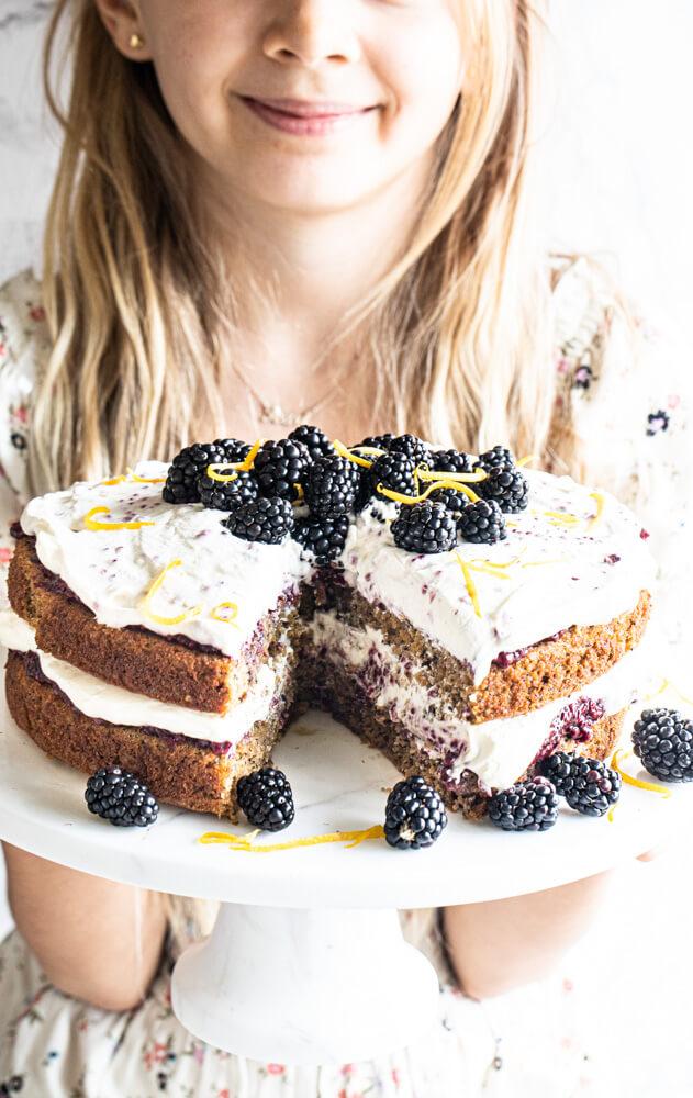 child holding cake