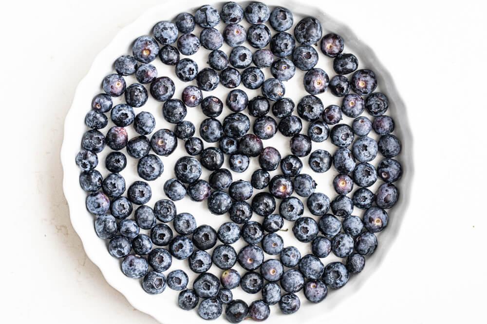 blueberries in white quiche pan