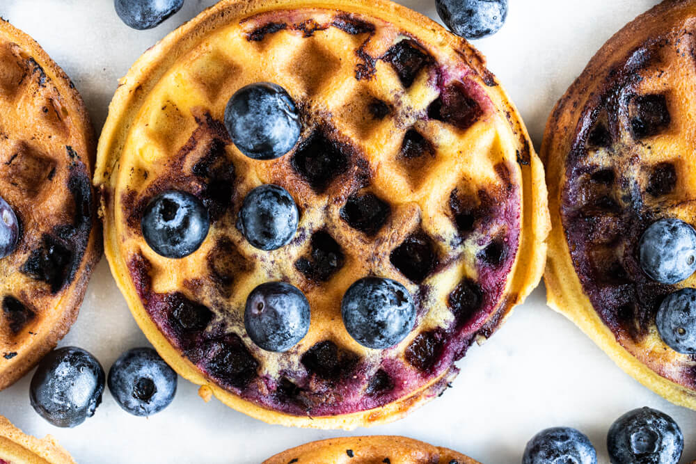 close up of mini waffle with blueberries