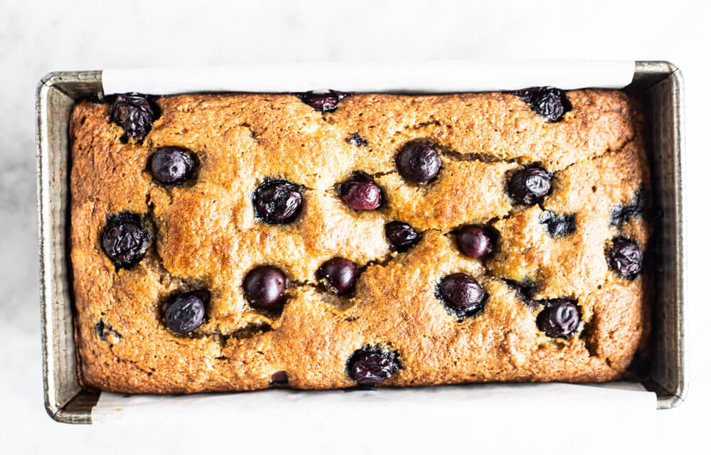 loaf of banana bread with blueberries on top