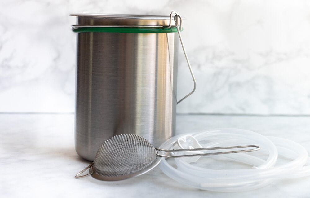 stainless enema bucket on white counter
